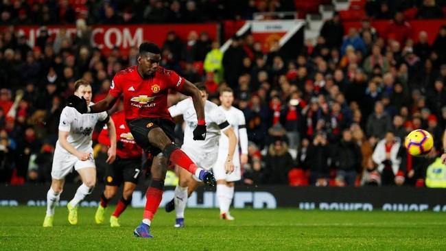 Paul Pogba berhasil mencetak gol pertama Manchester United di menit ke-87 lewat eksekusi penalti. (REUTERS/Phil Noble)