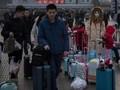 China Peringati Warga yang Akan Berlibur ke Amerika Serikat