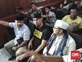Sidang Ujaran Idiot, Ahmad Dhani Pakai Kaus 'Tahanan Politik'