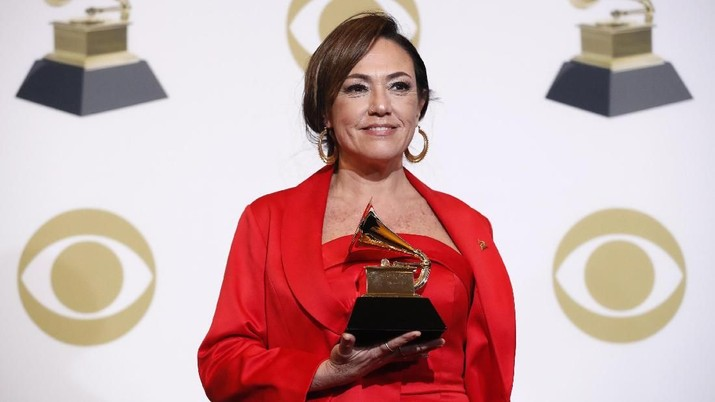 61st Grammy Awards - Photo Room - Los Angeles, California, U.S., February 10, 2019 - Claudia Brant poses backstage with her Best Latin Pop Album award for