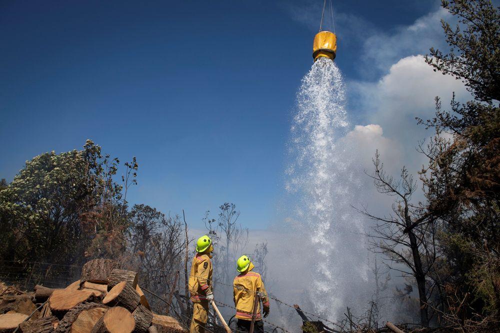 Api mulai melalap wilayah yang hanya berjarak 2 kilometer daripemukiman warga pada akhir pekan lalu. (Chad Sharman/New Zealand Defence Force/Handout via REUTERS)