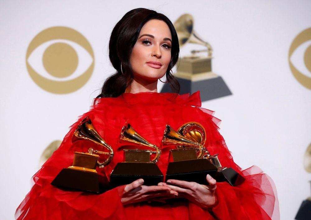 Penyanyi Kacey Musgraves berhasil memenangkan kategori Album of the Year, Best Country Album, Best Country Song, dan Best Country Solo Performance di Grammy Awards 2019. (REUTERS/Mario Anzuoni)