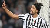 Juventus berhasil meyakinkan Sami Khedira bergabung setelah kontraknya bersama Real Madrid berakhir pada 2015. Khedira hingga kini masih menjadi andalan lini tengah Juventus. (MARCO BERTORELLO / AFP)