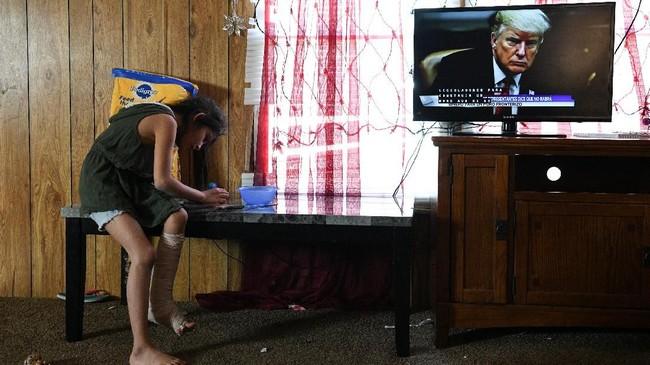 Carolina dan ibunya, Orfa, mengumpulkan niat dan memberanikan diri untuk kabur mencari kehidupan yang lebih baik di AS sejak beberapa tahun lalu. (Reuters/Loren Elliott)