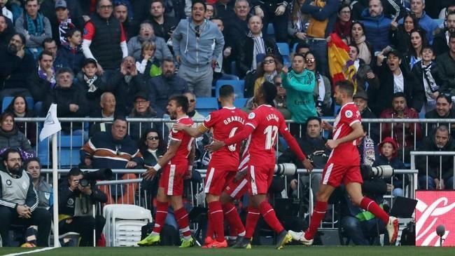 Girona kemudian berbalik unggul 2-1 atas Real Madrid melalui gol sundulan Portu pada menit ke-75. (REUTERS/Susana Vera)