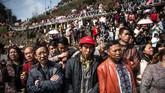 Etnis itu adalah minoritas dan yang paling banyak ditemukan di barat daya China. (Photo by FRED DUFOUR / AFP)