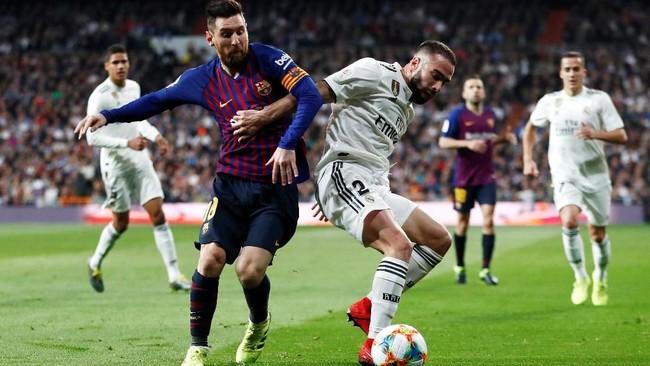 Barcelona bertandang ke markas Real Madrid dalam leg kedua semifinal Copa del Rey. Di leg pertama, kedua tim bermain imbang 1-1. (REUTERS/Juan Medina)