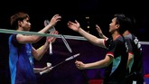 Mohammad Ahsan/Hendra Setiawan memenangkan gim penentuan dengan skor 21-12. (Reuters/Andrew Boyers)