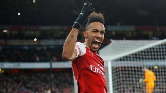 Pierre Emerick Aubameyang merayakan gol ke gawang Arsenal. Aubameyang mencetak 17 dari 27 gol di Liga Inggris pada hari Minggu atau sebanyak 63 persen. (REUTERS/Eddie Keogh)