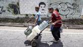 Venezuela kini mengalami krisis air sebagai dampak listrik padam selama lima hari. (Photo by JUAN BARRETO / AFP)