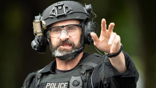 Ardern mengatakan Selandia Baru telah memberlakukan status keamanan tertinggi guna merespons insiden ini.(Reuters/SNPA/Martin Hunter)