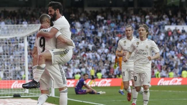 Isco yang sempat meredup di era Santiago Solari kembali bersinar di bawah kendali Zinedine Zidane. Gelandang asal Spanyol itu mencetak gol pembuka ke gawang Celta Vigo. (AP Photo/Paul White)