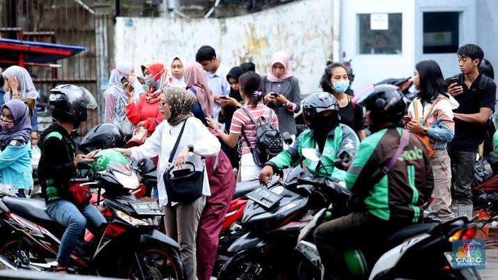Menkes setujui penerapan PSBB di DKI Jakarta. Artinya Grab dan Gojek harus setop bawa penumpang sementara waktu.