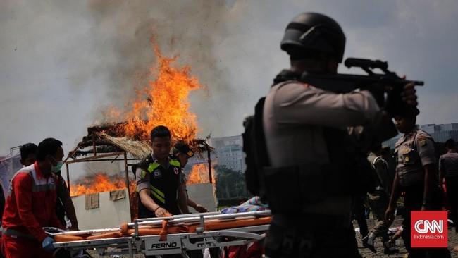 Menteri koordinator Bidang Politik, Hukum, dan Keamanan Wiranto pada Jumat pekan lalu menyatakan personel TNI-Polri yang dikerahkan untuk mengamankan Pemilu 2019 sebanyak 453.133 orang. (CNNIndonesia/Adhi Wicaksono)