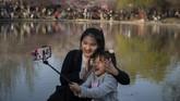 Biasanya bunga sakura di Taman Yuyuantan mekar pada bulan Maret hingga April. (Nicolas ASFOURI / AFP)