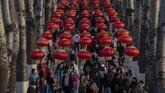 Kini penduduk Beijing dapat menikmati bunga Sakura, yang diperkirakan jumlahnya sudah melebihi 2.000 buah. (Nicolas ASFOURI / AFP)