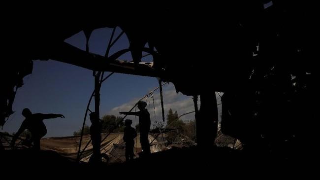 Sebelum ada klaim kesepakatan gencatan senjata, Israel justru meningkatkan serangan mereka atas Hamas. (REUTERS/Mohammed Salem)
