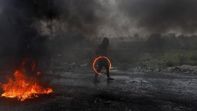 Salah satu faksi perjuangan Palestina di Jalur Gaza, Hamas, mendukung unjuk rasa itu. (REUTERS/Mohamad Torokman)