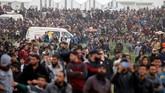 Warga Palestina di Tepi Barat dan Jalur Gaza memperingati setahun aksi unjuk rasa Gerakan Kembali ke Tanah Air (Great March of Return) pada Sabtu (30/3) lalu. (REUTERS/Mohamad Torokman)