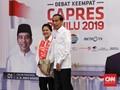 Gandeng Iriana, Jokowi Tiba di Lokasi Debat Keempat