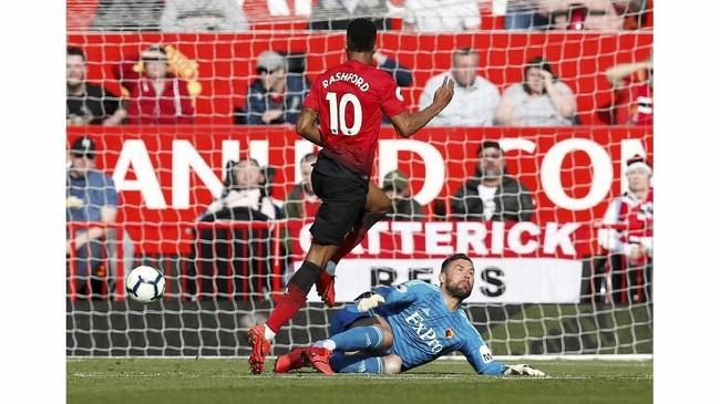 Man United butuh 28 menit untuk mengubah angka di papan skor. Marcus Rashford mencetak gol setelah menerima umpan dari Luke Shaw. (REUTERS/Andrew Yates)
