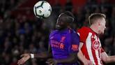 Kedua tim sempat mengalami kebuntuan mencetak gol tambahan hingga menit ke-80. Namun, mental pemain The Reds di 10 menit akhir mengubah hasil pertandingan. (Reuters/Andrew)