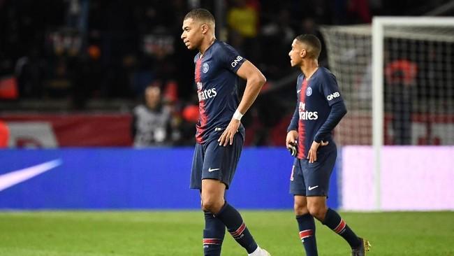 Paris Saint-Germain harus menunda pesta juara Ligue 1 setelah harus puas dengan tambahan satu poin dari laga ini.(Photo by Anne-Christine POUJOULAT / AFP)