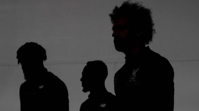 Pemain Liverpool Mohamed Salah, Naby Keita dan Divock Origi menjalani latihan terakhir di Melwood, Senin (8/4), jelang melawan FC Porto. (Reuters/Carl Recine)