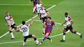 Belajar dari final 2009, Manchester United memberi penjagaan yang lebih kepada Lionel Messi pada final Liga Champions 2011. (AFP PHOTO / GLYN KIRK)