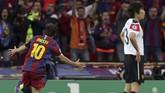 Lionel Messi merayakan gol ke gawang Manchester United pada final Liga Champions 2011. Gol ketiga Barcelona kemudian dicetak David Villa. (AFP PHOTO / ADRIAN DENNIS)