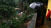 Wali Kota Rio de Janeiro menyatakan mereka saat dalam kondisi darurat akibat bencana tanah longsor. (REUTERS/Pilar Olivares)