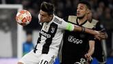 Mendapat kepercayaan dari pelatih Massimiliano Allegri menjadi starter saat melawan Ajax Amsterdam, Paulo Dybala hanya bermain 45 menit setelah tampil buruk. Posisinya kemudian digantikan Moise Kean. (Filippo MONTEFORTE / AFP)