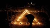Kamis Putih diperingati sebagai lambang dari Perjamuan Terakhir yang dilakukan Yesus dan 12 rasulnya. (Reuters/Darrin Zammit Lupi)