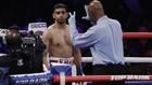 FOTO: Amir Khan Menyerah dan Kalah TKO
