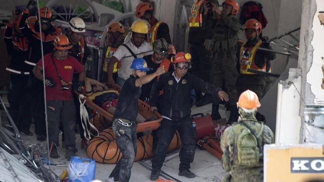 Gempa itu awalnya dilaporkan berkekuatan 6,3 dan kemudian direvisi turun menjadi 6,1 skala Richter, kata Survei Geologi AS dan seismologi Filipina. (Photo by Noel CELIS / AFP)