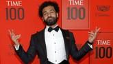 Mohamed Salah berpose di karpet merah. Pemain Liverpool adalah salah satu atlet yang terpilih masuk daftar 100 orang paling berpengaruh versi majalah Time. (REUTERS/Andrew Kelly)