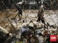 FOTO: Lumpur Sisa Banjir Jakarta