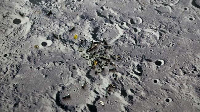 Deretan skrup yang terletak di atas lantai dengan gambar permukaan bulan sebelum pameran Hari Antariksa China di Changsha. (REUTERS/Aly Song)