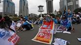 Para buruh yang tergabung dalam Asosiasi Serikat Pekerja Indonesia (ASPEK Indonesia) mengajukan tujuh tuntutan kepada pemerintah (REUTERS/Willy Kurniawan)
