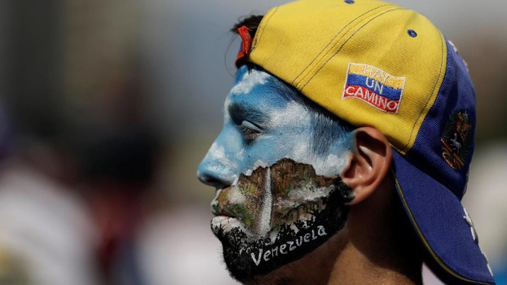 An opposition supporter with his face painted is seen during a rally against the government of Venezuela's President Nicolas Maduro and to commemorate May Day in Caracas Venezuela, May 1, 2019. REUTERS/Ueslei Marcelino
