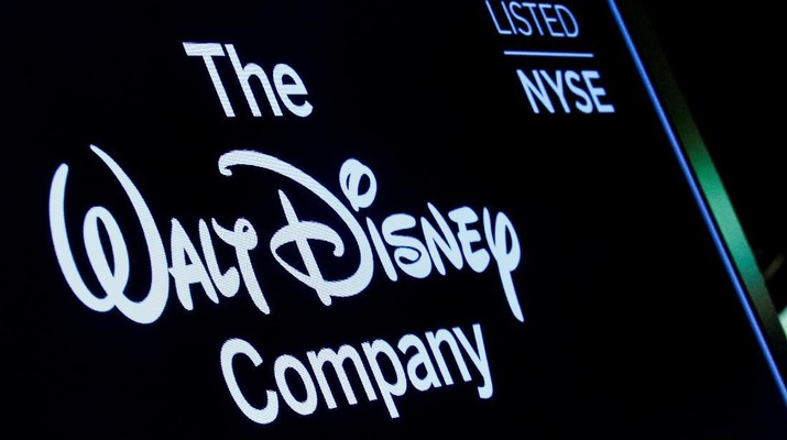 FILE PHOTO: A screen shows the logo and a ticker symbol for The Walt Disney Company on the floor of the New York Stock Exchange (NYSE) in New York, U.S., December 14, 2017. REUTERS/Brendan McDermid/File Photo