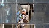 Teror bom dan penembakan dengan sasaran kantor lembaga swadaya masyarakat Amerika Serikat, Counterpart International, itu menewaskan lima orang. (Reuters/Omar Sobhani)