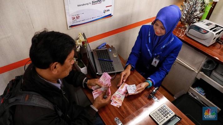 Pukul 09:00 WIB: Rupiah Lanjutkan Pelemahan ke 14.460/US$
