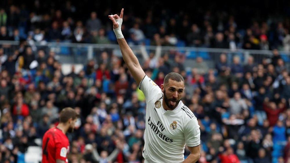 Karim Mostafa Benzema adalah seorang pemain sepak bola profesional Prancis keturunan Aljazair yang saat ini bermain untuk tim La Liga Spanyol, Real Madrid. Bersama Real Madrid ia meraih gelar yang paling berharga Champions League di tahun 2014, 2016, 2017, dan 2018.REUTERS/Susana Vera