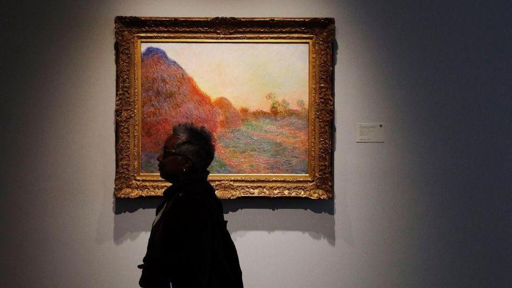 Satu lukisan cat minyak berjudul Meules dan selesai pada 1890 itu terjual seharga US$110,7 juta atau sekitar Rp 1,6 triliun, Selasa (14/5/2019). Nilai ini mencetak rekor untuk karya lukisan impresionis. (REUTERS/Lucas Jackson)