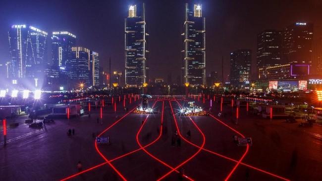 Perlambatan pertumbuhan ekonomi China, terutama disebabkan memanasnya perang dagang dengan Amerika Serikat. (REUTERS/Thomas Peter)