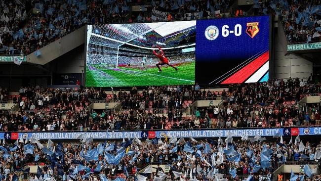 Kemenangan dengan skor 6-0 atas Watford membuat Manchester City sejajar dengan Blackburn Rovers dan Bury yang juga berhasil mencetak enam gol dalam final turnamen paling tua di dunia tersebut. (REUTERS/Toby Melville)