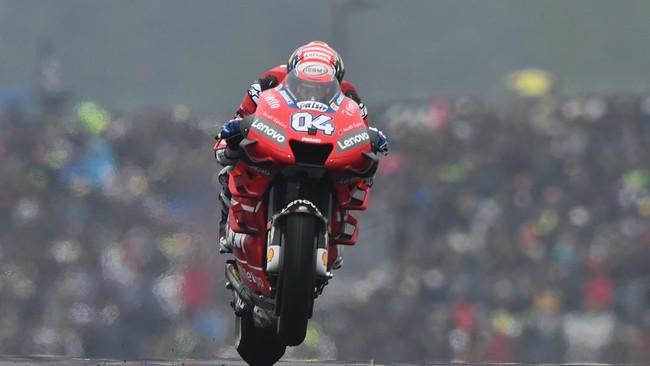 Andrea Dovizioso yang tertinggal tiga poin di klasemen pebalap akan mengawali lomba dari posisi start keempat atau baris kedua. (JEAN-FRANCOIS MONIER / AFP)