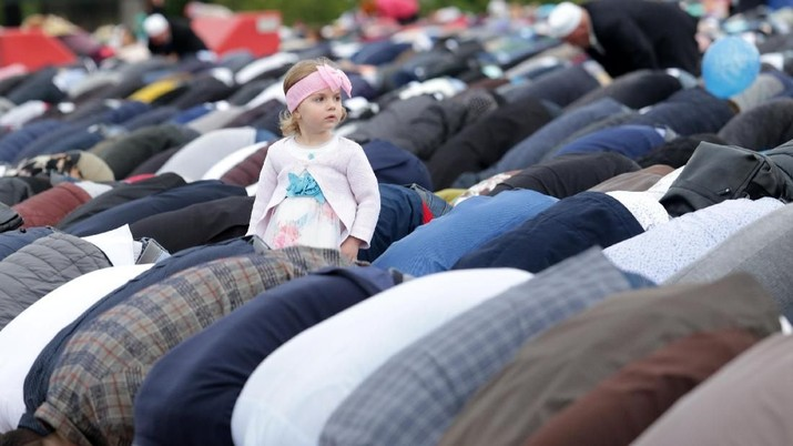A girl is seen as Albanian Muslims attend the morning prayers of Eid al-Fitr, marking the end of the holy month of Ramadan in Skanderbeg square Tirana, Albania June 4, 2019 REUTERS/Florion Goga
