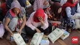 Uang zakat fitrah yang terkumpul sebesar Rp500 juta itu, nantinya akan diganti ke bentuk beras sebelum dibagikan. (CNN Indonesia/Adhi Wicaksono)